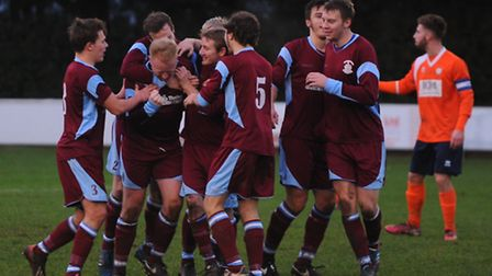 Thetford's players celebrate a goal against Diss. Picture by: Sonya Duncan