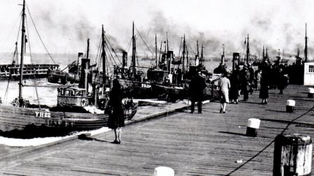 MAINSAFELY BACK: a classic scene of drifters entering the harbour pre-war to land their herring catc