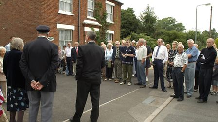 PAYING TRIBUTE: Belton villagers and others gather outside Waveney House in 2006, scene of a 1944 cr