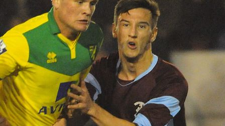 Elliot Smith, pictured (right) marking Norwich City's Cameron McGeehan in the Norfolk Senior Cup ear
