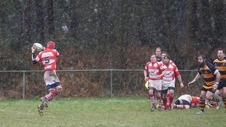 Action from Thetford's (red) 15-10 home defeat to league leaders Southwold at Two Mile Bottom.