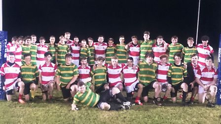 Thetford RFC U16s (red) with opponents Crusaders U16s at Two Mile Bottom.