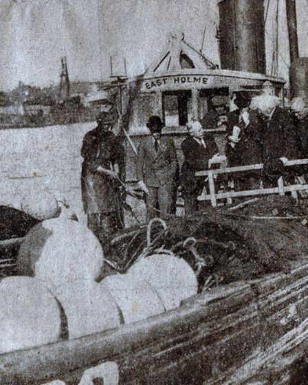 SILVER HARVEST: the bowler-hatted Prince, in front of the wheelhouse of the Yarmouth drifter East Ho