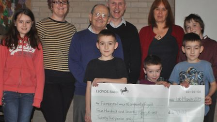 Flynn, Aston and Jacob Mace receive the cheque on behalf of Fulmerston Family and Community Project