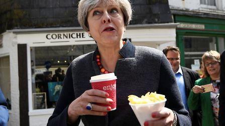 Prime Minister Theresa May having some chips while on a walkabout during a election campaign stop in
