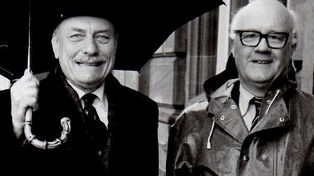 TORY WET? No: Enoch Powell's umbrella keeps him dry as he arrives at the Town Hall.