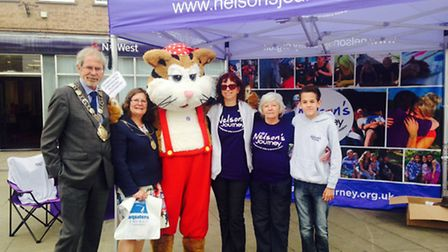 Robert Kybird, mayor of Thetford, Glynis Irish, mayoress, with Nelson the cat and staff from the cha