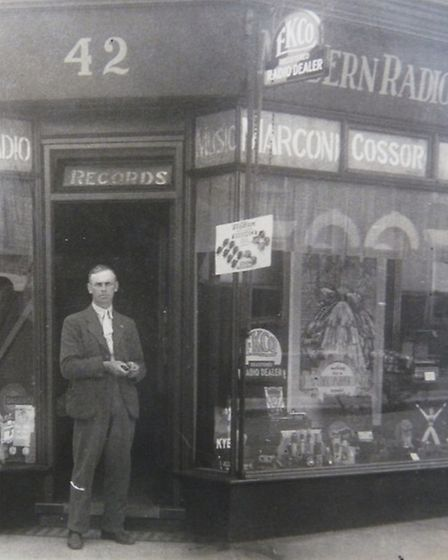 TUNED IN: Tom Allard outside his Modern Radio & Music shop in Bells Road in 1935. Some of the advert