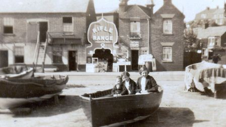 MAINPEGGOTTY PROPERTY?: Hawkins family children enjoy a dry boat trip in the Thirties, opposite buil