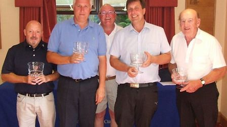 The winning team of Tony Noakes, John Sampson, Bob Powley and Bill Sawings show off their Captain's