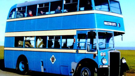 MAIN PIC = ARMS BEARER: a Great Yarmouth Corporation bus with the heraldic shield in the diamond on