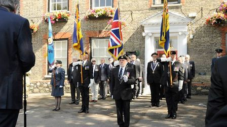 Standards raised outside Kings House in Thetford to mark VJ Day