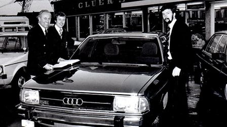 WANT A NEW MOTOR? Joe Cluer (left) and colleagues at his new garage and showroom opened in 1965.Pict