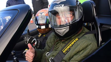 Drivers and passengers enjoy the charity track day at Snetterton race track. Emma Bloomfield and Rob