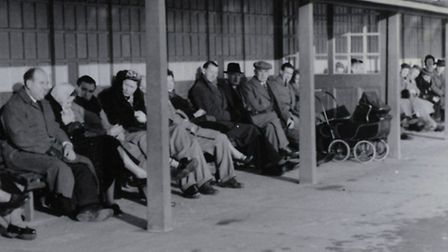 BEFORE OR AFTER THE TURKEY? People enjoying Christmas sunshine in Gorleston beach shelters in 1953.