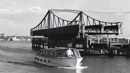 ONE GOOD TURN...lets a holiday cruiser pass by. Reedham swing bridge, pictured in 1970, one of the p