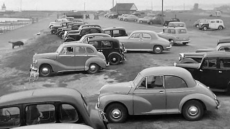 BEFORE THE BLOCKADE: motorists parked on the South Denes at Great Yarmouth enjoy sea views in 1954.P