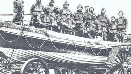 LIFESAVERS: Yarmouth lifeboat trundles across the beach on its launch carriage early last century. P