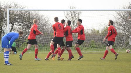 Football action from the Norfolk Junior Cup semi-final: Runton Utd (blue) v Mundford (red). Picture:
