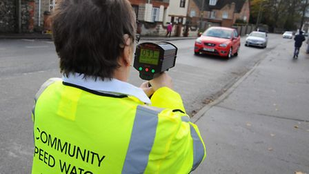 Margaret Rutter uses the speedwatch team's camera. Photo: Sonya Duncan