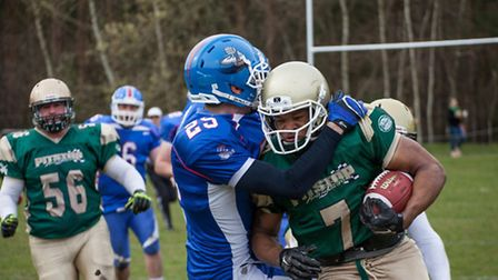 Action from Bury Saints' win over Sussex Thunder at Thetford Rugby Club - No 7 RB Cory Jenkins. Pict