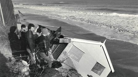 FLOODING IN 1983: work starts to right an overturned on Hemsby beach after the tidal surge.Picture: