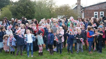 Villagers in Barnham watch the beacon lit for the Queen's Birthday.