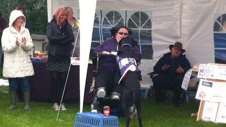 Hannah demonstrates with her assistance dog Higgins at the Canine Partners dog show and fun day in B