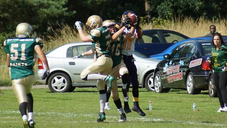 Action from Bury Saints 39-13 win over Colchester Gladiators in Thetford - FS Luke Cowley challenges
