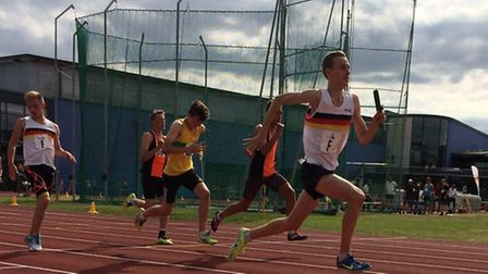 Aiden Try running the second leg of the 4 x 100m sprint relay for Team Norfolk during a Youth Develo