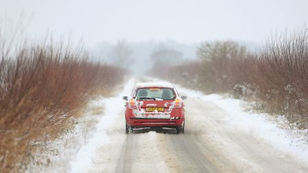 A car on a snow covered minor road near Halvergate. Picture: James Bass