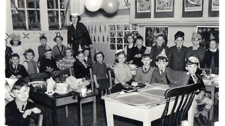 Class 2 with teacher Miss Rainer at the St Andrew's School in Great Yarmouth in 1954, decorated for