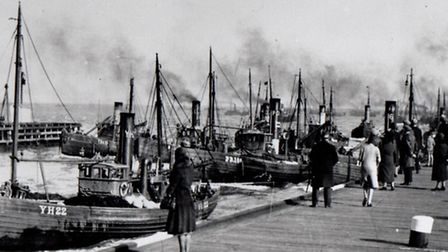 The Harbour's Mouth, a squeeze for jostling herring drifters returning to port probably in the 1920s