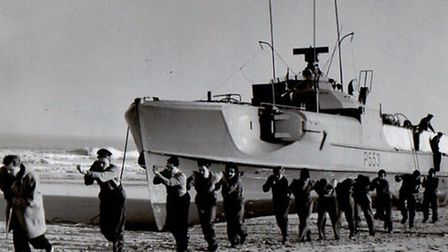 MAIN High and dry on Scroby on Christmas Eve 1952, the Havoernen's crew and others haul a hawser ac