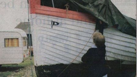 Former Titanic lifeboat? Patricia Goreham helps her husband, Geoffrey, to remove the tarpaulin from