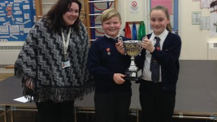 Harriers' House Captains Callum Western and Jessie Crickmore being presented with the House Cup by A