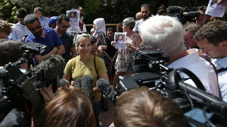 Lily Allen speaks to the media at a protest outside Kensington Town Hall