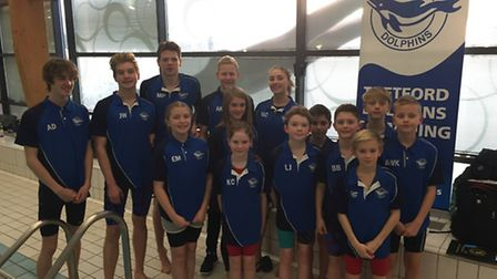 Thetford dolphins with swimmers who competed at the Norfolk Championships.