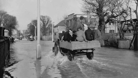Uncomfortable but getting there...a journey along a flooded Southtown Road in 1953.