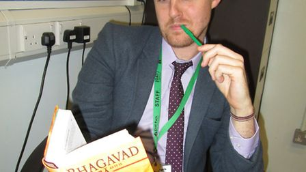 Mr Vickers curls up with some Hindu scripture for World Book Day.