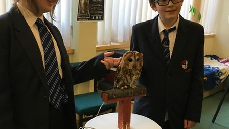 Natasha Pearson-Guelmane and Peter Gymer with one of the owls visiting Lynn Grove Academy for World
