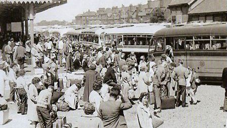 Happy to be here! Holidaymakers arriving at Beach Coach Station in 1962.