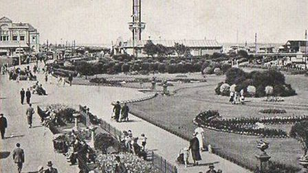 The Revolving Tower is dominant as people stroll along a tranquil Marine Parade in Great Yarmouth in