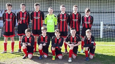 Mundford's Under-14 footballers face the camera. Picture: David Bunn