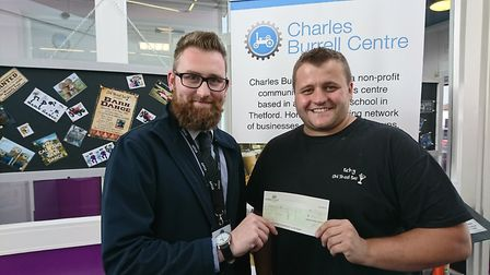 Old Skool Bar bar owner Ricky Jermy (right) presents the Charles Burrell Centre manager Mark Snowdon