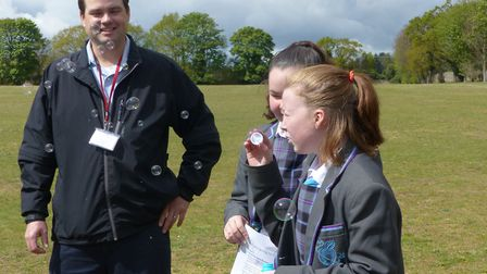 Weather forecaster Chris Bell with IES Breckland pupls Kira and Paige. Picture: IES Breckland