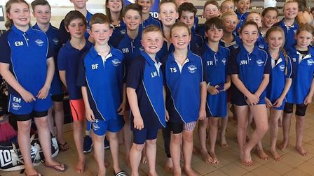Thetford Dolphins swimmer pose for a team picture at Newmarket. Picture: Steve King