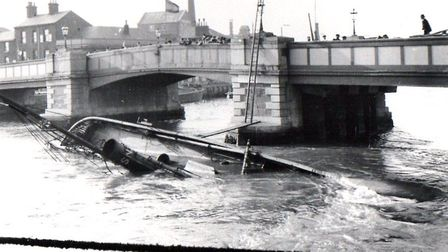 The North Shields drifter Gannet, on the river bed after a collision with the old Haven Bridge 110 y