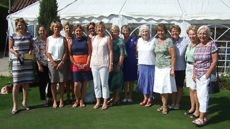 Swaffham Ladies Am-Am prize winners with the club's ladies' president and ladies' captain. Picture: