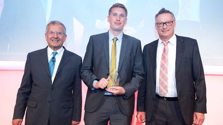Jamie Cash of Century Logistics pictured with Gerald Ratner after winning the UK Warehousing Associa